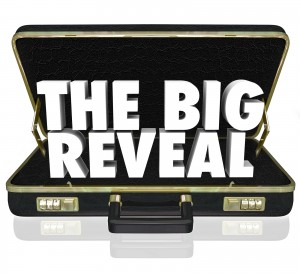 A black leather briefcase with words The Big Reveal inside as a